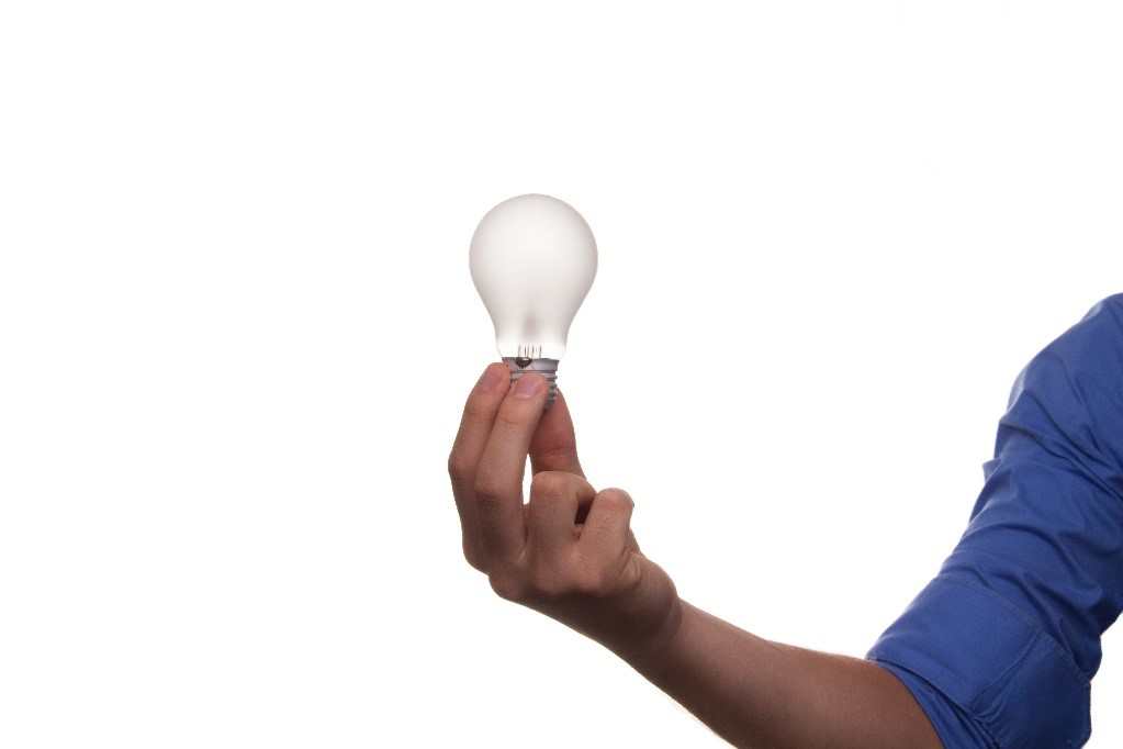 Man standing with light bulb